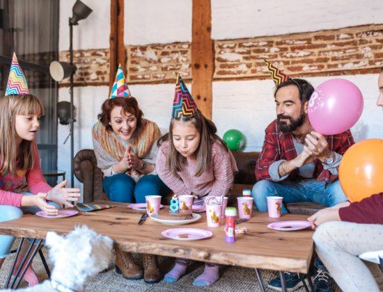 Happy family celebrating little girl birthday
